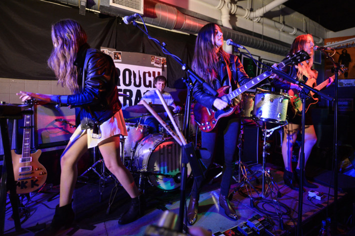 Alana Haim, Dash Hutton, Danielle Haim and Este Haim of the band Haim perform on stage at Rough Trade East on October 1, 2013 in London, England.  (Photo by Andy Sheppard/Redferns via Getty Images)