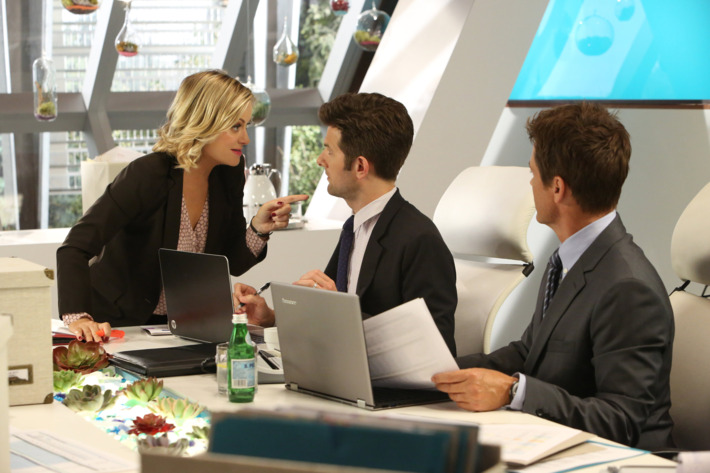 """PARKS AND RECREATION -- """"The Pawnee-Eagleton Tip Off Classic"""" Episode 603 -- Pictured: (l-r) Amy Poehler as Leslie Knope, Adam Scott as Ben Wyatt, Rob Lowe as Chris Traeger -- (Photo by: Danny Feld/NBC)"""