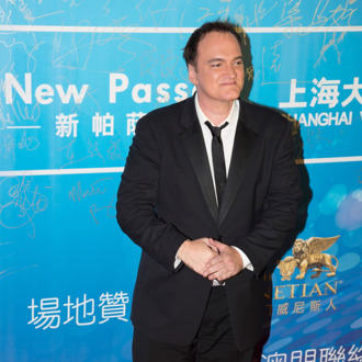 MACAU - OCTOBER 07: American director Quentin Tarantino poses on the red carpet during the 2013 Huading Awards Ceremony at The Venetian on October 7, 2013 in Macau, Macau. (Photo by Lam Yik Fei/Getty Images for Global Talents Media Group)