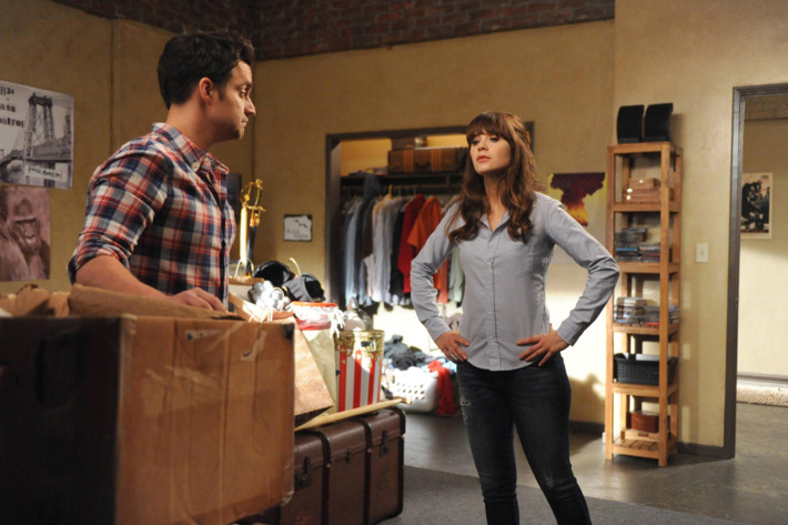 """NEW GIRL:  Nick (Jake Johnson, L) shows Jess (Zooey Deschanel, R) his box of unwanted responsibilities in the """"The Box"""" episode of NEW GIRL airing Tuesday, Oct. 15 (9:00-9:30 PM ET/PT) on FOX. ?2013 Fox Broadcasting Co. Cr: Ray Mickshaw/FOX"""