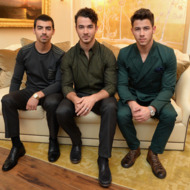 Joe Jonas, Kevin Jonas, and Nick Jonas of the Jonas Brothers attend the Mercedes-Benz Star Lounge during Mercedes-Benz Fashion Week Spring 2014 at Lincoln Center on September 5, 2013 in New York City.