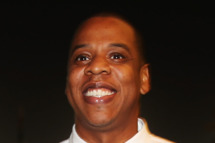 Musician Jay-Z arrives in the F1 paddock following practice for the Abu Dhabi Formula One Grand Prix at the Yas Marina Circuit on November 1, 2013 in Abu Dhabi, United Arab Emirates.