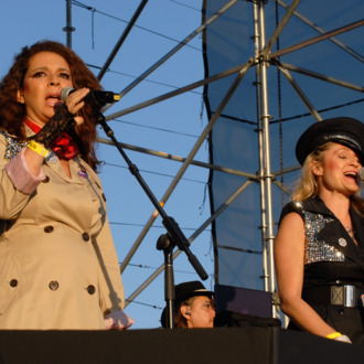 SANTA MONICA, CA - OCTOBER 19: Actresses Maya Rudolph and Amy Poehler perform at the Festival Supreme comedy and music festival on the Santa Monica Pier on October 19, 2013 in Santa Monica, California. (Photo by Michael Tullberg/Getty Images)