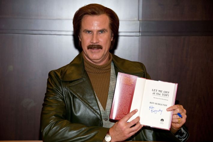 """Anchorman Ron Burgundy signs copies of his new book """"Let Me Off At The Top: My Classy Life And Other Musings"""" at Barnes & Noble bookstore at The Grove on November 20, 2013 in Los Angeles, California."""