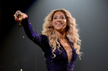 """LOS ANGELES, CA - DECEMBER 03:  Entertainer Beyonce performs on stage during """"The Mrs. Carter Show World Tour"""" at the Staples Center on December 3, 2013 in Los Angeles, California.  (Photo by Larry Busacca/PW/WireImage for Parkwood Entertainment)"""