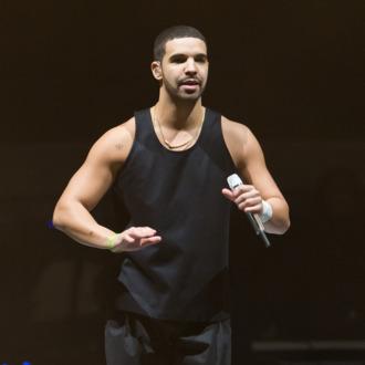 PHILADELPHIA, PA - DECEMBER 18: Rapper Drake performs during the
