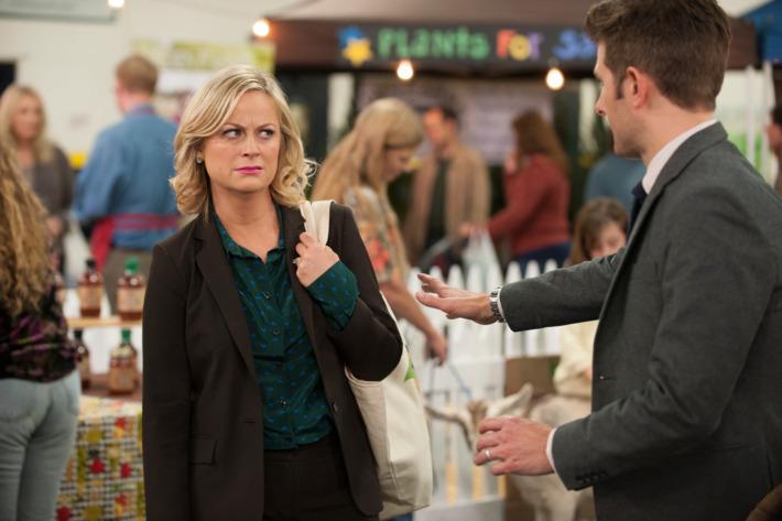 "PARKS AND RECREATION -- ""Farmer's Market"" Episode 612 -- Pictured: (l-r) Amy Poehler as Leslie Knope, Adam Scott as Ben Wyatt."