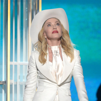 LOS ANGELES, CA - JANUARY 26: Singer Madonna performs onstage during the 56th GRAMMY Awards at Staples Center on January 26, 2014 in Los Angeles, California. (Photo by Kevork Djansezian/Getty Images)