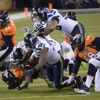 EAST RUTHERFORD, NJ - FEBRUARY 2: Denver Broncos running back Knowshon Moreno (27) fumbles the ball during the first quarter. The ball was received by Denver Broncos guard Zane Beadles (68). The Denver Broncos vs the Seattle Seahawks in Super Bowl XLVIII at MetLife Stadium in East Rutherford, New Jersey Sunday, February 2, 2014. (Photo by AAron Ontiveroz/The Denver Post)
