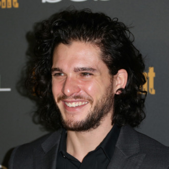 WEST HOLLYWOOD, CA - SEPTEMBER 20: Actor Kit Harrington arrives at Entertainment Weekly's Pre-Emmy Party at Fig & Olive Melrose Place on September 20, 2013 in West Hollywood, California. (Photo by Frederick M. Brown/Getty Images)