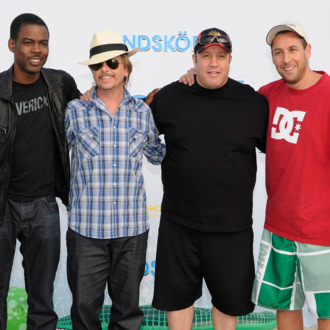 BERLIN - JULY 30: Actors Chris Rock, David Spade, Kevin James and Adam Sandler attend the Beach BBQ for the German Premiere of 'Kindskoepfe' (Grown Ups) at O2 World on July 30, 2010 in Berlin, Germany. (Photo by Toni Passig/WireImage) *** Local Caption *** Chris Rock;David Spade;Kevin James;Adam Sandler