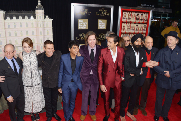 """NEW YORK, NY - FEBRUARY 26:  (L-R) Actors/castmembers Bob Balaban, Saoirse Ronan, Willem Dafoe, Tony Revolori, filmmaker Wes Anderson, and actors/castmembers Harvey Keitel, Adrien Brody, Waris Ahluwalia, F. Murray Abraham and attend the """"The Grand Budapest Hotel"""" New York Premiere at Alice Tully Hall on February 26, 2014 in New York City.  (Photo by Michael Loccisano/WireImage)"""