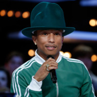 """US singer Pharrell Williams looks on as he takes part in the """"Le Grand Journal"""" TV show at the headquarters of the French television channel Canal Plus in Paris, on February 24, 2014. AFP PHOTO / THOMAS SAMSON        (Photo credit should read THOMAS SAMSON/AFP/Getty Images)"""