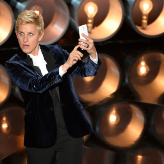 HOLLYWOOD, CA - MARCH 02: Host Ellen DeGeneres speaks onstage during the Oscars at the Dolby Theatre on March 2, 2014 in Hollywood, California. (Photo by Kevin Winter/Getty Images)