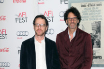 "HOLLYWOOD, CA - NOVEMBER 14:  Directors Ethan Coen (L) and Joel Coen attend the AFI FEST 2013 presented by Audi Closing Night Gala Screening of ""Inside Llewyn Davis"" at the TCL Chinese Theatre on November 14, 2013 in Hollywood, California.  (Photo by David Livingston/Getty Images)"