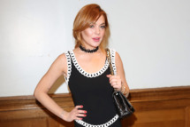 LONDON, ENGLAND - JUNE 16:  Lindsay Lohan attends the Moschino show during the London Collections: Men SS15 at Lindley Hall on June 16, 2014 in London, England.  (Photo by Tim P. Whitby/Getty Images)