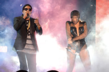 """MIAMI GARDENS, FL - JUNE 25:  Jay-Z and Beyonce perform during opening night of the """"On The Run Tour: Beyonce And Jay-Z"""" at Sun Life Stadium on June 25, 2014 in Miami Gardens, Florida.  (Photo by Kevin Mazur/WireImage for Parkwood Entertainment)"""