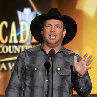 LAS VEGAS, NV - APRIL 06: Singer/songwriter Garth Brooks speaks onstage during the 49th Annual Academy Of Country Music Awards at the MGM Grand Garden Arena on April 6, 2014 in Las Vegas, Nevada. (Photo by Ethan Miller/Getty Images)