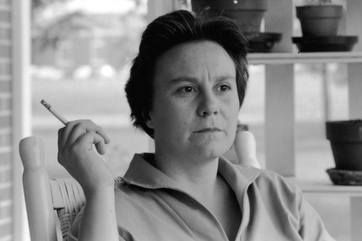 Author Harper Lee smoking cigarette on porch.