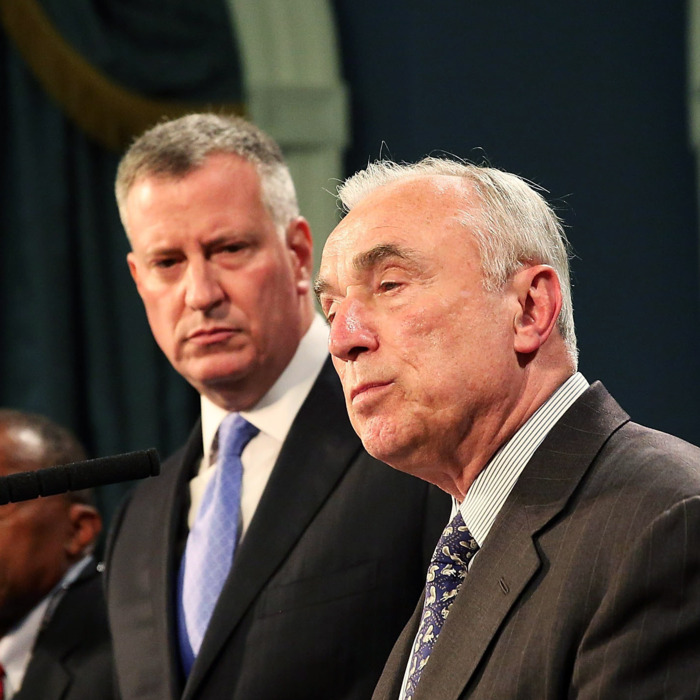 NEW YORK, NY - JULY 18: New York Mayor Bill de Blasio (center) and New York Police Commissioner William Bratton speak to the media at a news conference to address the recent death of a man in police custody on July 18, 2014 in New York City. The mayor has promised a full investigation into the circumstances surrounding the death of Eric Garner after he was taken into police custody in Staten Island yesterday. A 400-pound, 6-foot-4 asthmatic, Garner (43) died after police put him in a chokehold outside of a conveinence store for illegally selling cigarettes. (Photo by Spencer Platt/Getty Images)