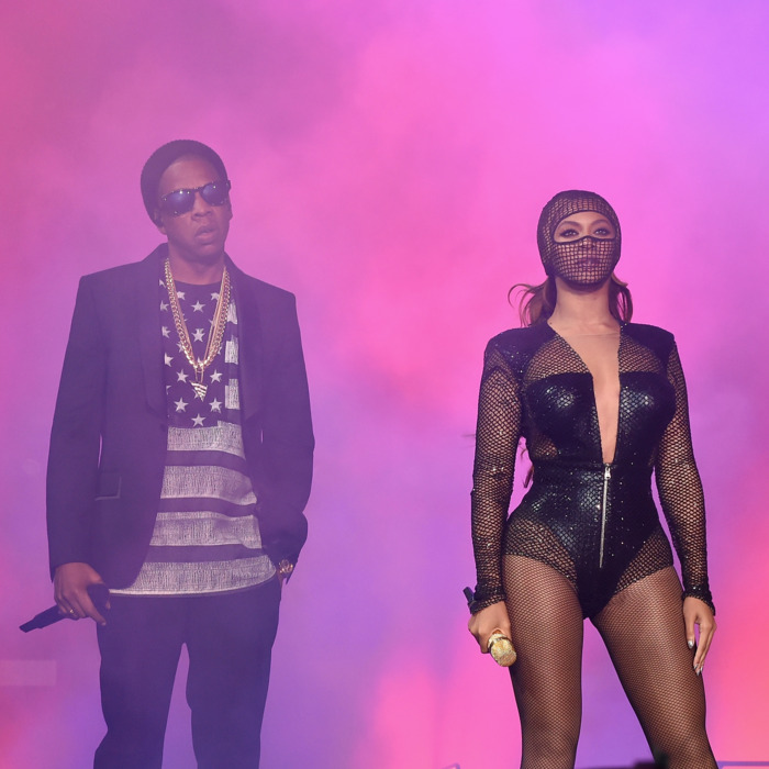CHICAGO, IL - JULY 24: Jay-Z (L) and Beyonce perform onstage during the