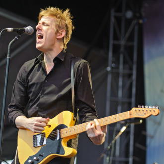 LOUISVILLE, KY - JULY 18: Britt Daniel of Spoon performs during the 2014 Forecastle Music Festival at Louisville Waterfront Park on July 18, 2014 in Louisville, Kentucky. (Photo by Timothy Hiatt/WireImage)