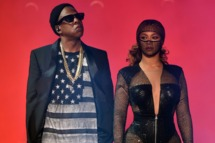 """Jay-Z (L) and Beyonce perform during the """"On The Run Tour: Beyonce And Jay-Z"""" at the Rose Bowl on August 2, 2014 in Pasadena, California."""