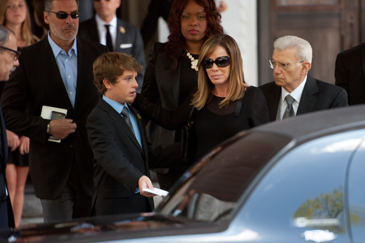 NEW YORK, NY - SEPTEMBER 07:  Melissa Rivers (2nd R) and son Cooper Endicott attend the Joan Rivers memorial service at Temple Emanu-El on September 7, 2014 in New York City. Rivers passed away on September 4, 2014 after suffering respiratory and cardiac arrest during vocal cord surgery on August 28, 2014.  (Photo by D Dipasupil/Getty Images)