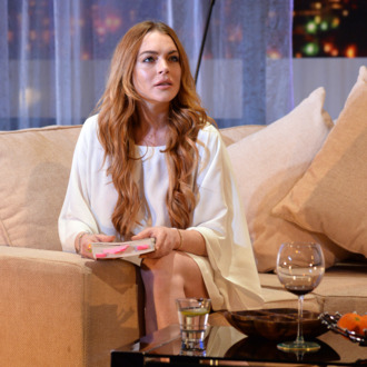 LONDON, ENGLAND - SEPTEMBER 30: Lindsay Lohan performs during a photocall for