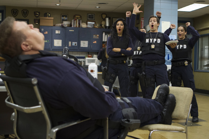 """BROOKLYN NINE-NINE: Detectives Diaz (Stephanie Beatriz, second from L), Peralta (Andy Samberg, third from L) and Santiago (Melissa Fumero, R) have fun with Scully (Joel Mckinnon MIller, L) in the """"Jimmy Jab Games"""" episode of BROOKLYN NINE-NINE airing Sunday, Oct. 12 (8:30 - 9:00) PM ET/PT) on FOX. ?2014 Fox Braodcasting Co. CR: Eddy Chen/FOX"""