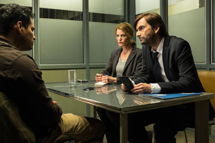 """GRACEPOINT: Mark Solano (Michael Pe?a, L) is questioned by Detectives Emmett Carver (David Tennant, R) and Ellie Miller (Anna Gunn, C) in """"Episode Three"""" of GRACEPOINT airing Thursday, Oct. 9 (9:00-10:00 PM ET/PT) on FOX. ?2014 Fox Broadcasting Co. Cr: Ed Araquel/FOX"""