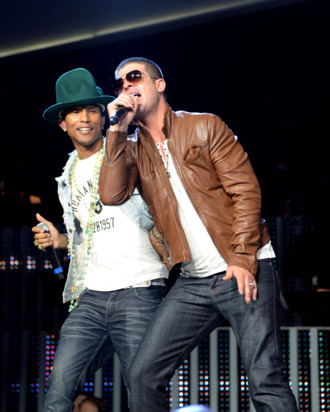 FAYETTEVILLE, AR - JUNE 06: Pharrell Williams and Robin Thicke perform during the Walmart 2014 annual shareholdersmeeting on June 6, 2014 at Bud Walton Arena at the University of Arkansas in Fayetteville, Arkansas. (Photo by Jamie McCarthy/Getty Images for Walmart)