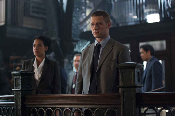 """GOTHAM: An unwelcome visitor searches for Detective James Gordon (Ben McKenzie, R) at the GCPD in the """"Penguin's Umbrella"""" episode of GOTHAM airing Monday, Nov. 3 (8:00-9:00 PM ET/PT) on FOX. Also pictured: Zabryna Guevara. ?2014 Fox Broadcasting Co. Cr: Jessica Miglio/FOX"""