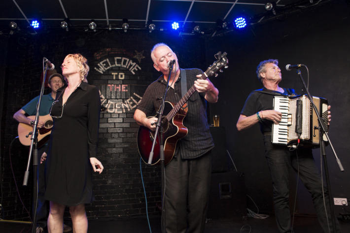 LEEDS, UNITED KINGDOM - AUGUST 06: Sally Timms, Jon Langford and Rico Bell of The Mekons perform on stage at Brudenell Social Club on August 6, 2014 in Leeds, United Kingdom. (Photo by Andrew Benge/Redferns via Getty Images)