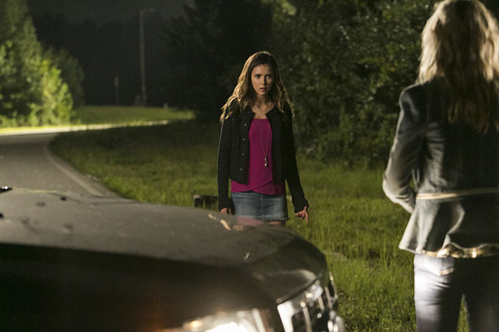 """The Vampire Diaries -- """"The More You Ignore Me, The Closer I Get"""" -- Image Number: VD606a_0195.jpg -- Pictured (L-R): Nina Dobrev as Elena and Candice Accola as Caroline (back to camera) -- Photo: Tina Rowden/The CW -- ?'?? 2014 The CW Network, LLC. All rights reserved."""