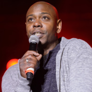 CHICAGO, IL - SEPTEMBER 21:  Dave Chapelle performs on stage during AAHH!! Fest 2014 at Union Park on September 21, 2014 in Chicago, United States.  (Photo by Daniel Boczarski/Redferns via Getty Images)
