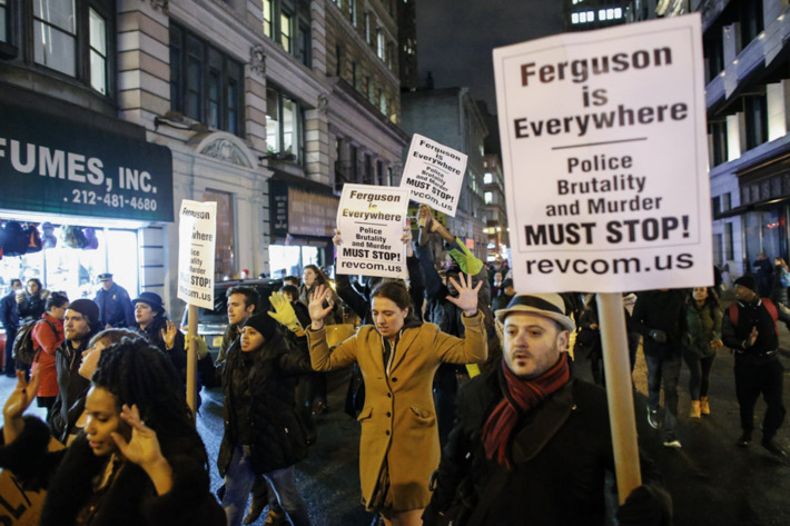 NEW YORK, NY - DECEMBER 3: People take part in a protest in Manhattan after a grand jury decided not to indict New York Police Officer Daniel Pantaleo in Eric Garner's death on December 3, 2014 in New York City. Eric Garner was killed by a police officer Daniel Pantaleo on July 17, 2014 after Pantaleo suspected him of selling untaxed cigarettes and putting him in a choke hold.  (Photo by Kena Betancur/Getty Images)
