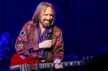 CLARKSTON, MI - AUGUST 24:  Tom Petty and the Heartbreakers perform at DTE Energy Music Theater on August 24, 2014 in Clarkston, Michigan.  (Photo by Scott Legato/Getty Images)