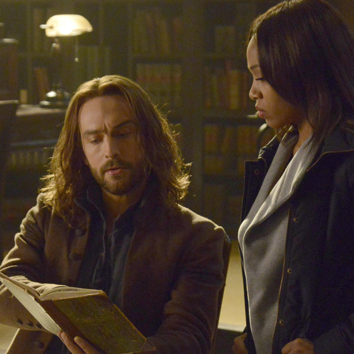 SLEEPY HOLLOW: Ichabod (Tom Mison, L) and Abbie (Nicole Beharie, R) look for a dangerous book of spells in the