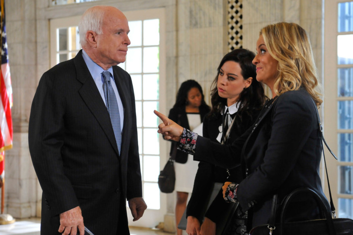 "PARKS AND RECREATION -- ""Ms. Ludgate-Dwyer Goes to Washington"" Episode 709 -- Pictured: (l-r) Senator John McCain, Aubrey Plaza as April Ludgate, Amy Poehler as Leslie Knope -- (Photo by: Larry French/NBC)"