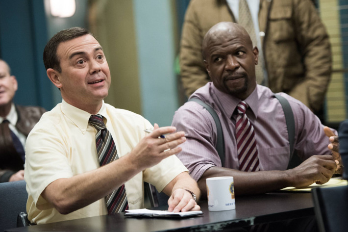 """BROOKLYN NINE-NINE: Det. Boyle (Joe Lo Truglio, L) and Sgt. Jeffords (Terry Crews, R) listen in for their next assignment in the """"The Wednesday Incident"""" episode of BROOKLYN NINE-NINE airing Sunday, Feb. 15 (8:30-9:00 PM ET/PT) on FOX. ?2015 Fox Broadcasting Co. CR: Eddy Chen/FOX"""