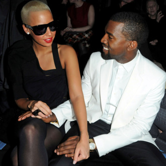 Kanye West and Amber Rose attend the Givenchy Fashion Show during Paris Fashion Week Haute Couture S/S 2010 on January 26, 2010 in Paris, France. (Photo by Pascal Le Segretain/Getty Images) *** Local Caption *** Kanye West;Amber Rose