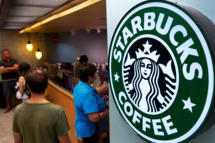Customers queue for coffee at Starbucks Coffee inside the Dulles International Airport complex on August 30, 2011 in Dulles, Virginia, near Washington, DC.    AFP Photo/Paul J. Richards (Photo credit should read PAUL J. RICHARDS/AFP/Getty Images)