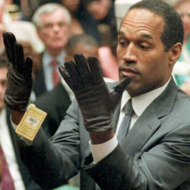 LOS ANGELES, UNITED STATES:  (YEARENDER 13) O.J. Simpson looks at a new pair of Aris extra-large gloves that prosecutors had him put on 21 June 1995 during his double-murder trial in Los Angeles. Simpson was acquitted of charges of murdering his ex-wife Nicole Simpson and her friend Ronald Goldman.  AFP PHOTO by Vince BUCCI (Photo credit should read Vince Bucci/AFP/Getty Images)