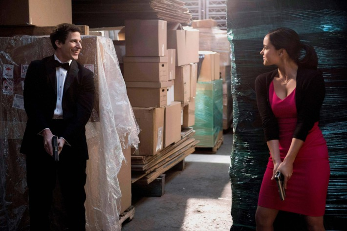 """Det. Peralta (Adam Samberg, L) and Det. Santiago (Melissa Fumero, R) get sidetracked chasing a criminal on the day of Gina and Charles' parents' wedding in the """"Boyle-Linetti Wedding"""" episode of BROOKLYN NINE-NINE."""