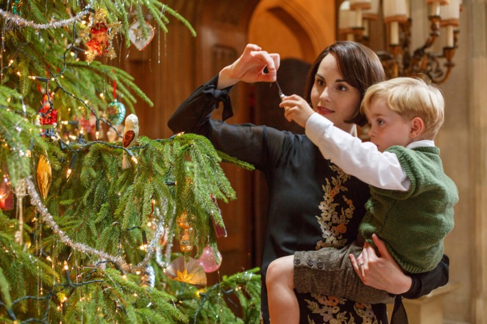 The Crawleys go to a shooting party at a castle in Northumberland and return to Downton for a joyful Christmas holiday. Shown from left to right: Michelle Dockery as Lady Mary and Oliver/Zac Barker as Master George Crawley.