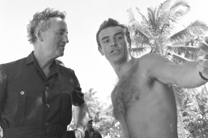 During location filming in Jamaica, Ian Fleming gives SEAN CONNERY some first-hand pointers on his portrayal of James Bond, Fleming's Agent 007.