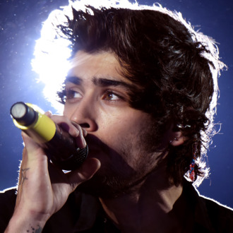PASADENA, CA - SEPTEMBER 11: (EDITORIAL USE ONLY; NO COVERS; NO USE IN ANY MAGAZINE OR OTHER PUBLICATION BASED PREDOMINANTLY ON ONE DIRECTION OR ANY ONE OR MORE MEMBERS OF ONE DIRECTION) Singer Zayn Malik of One Direction performs onstage during the One Direction