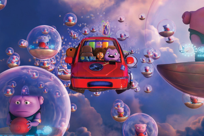 HOME_sq2050_s7.pub_custom_f171_v2.0 The odd couple of friends Tip (Rihanna) and Oh (Jim Parsons) navigate their way through a crowded sky of bubble-driving Boov. Photo credit: DreamWorks Animation.