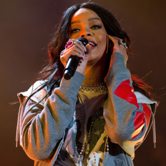 INDIANAPOLIS, IN - APRIL 04: Rihanna performs live onstage at White River State Park on April 4, 2015 in Indianapolis, Indiana. (Photo by Joey Foley/WireImage)